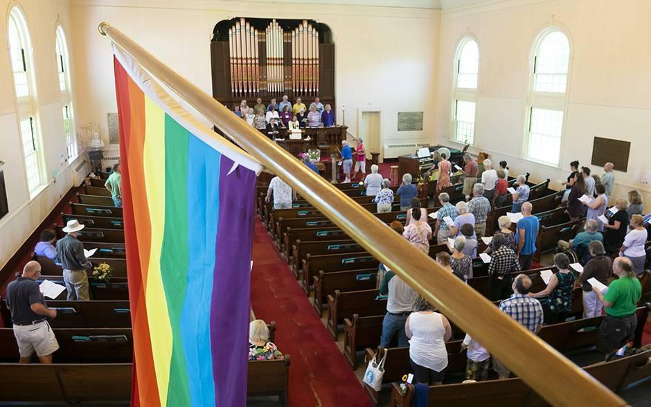 Rainbow flag from balcony of First Parish Church