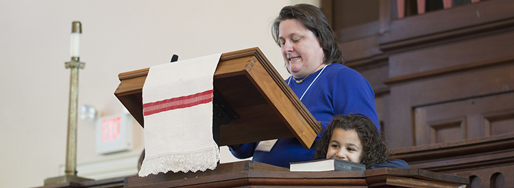 A mother and daughter at the pulpit at First Parish
